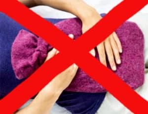Не разрешается прикладывание сухого тепла на живот